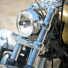 bates style, vintage style, old school, early model, retro, Side mount headlight with a black housing, and a 5-3/4